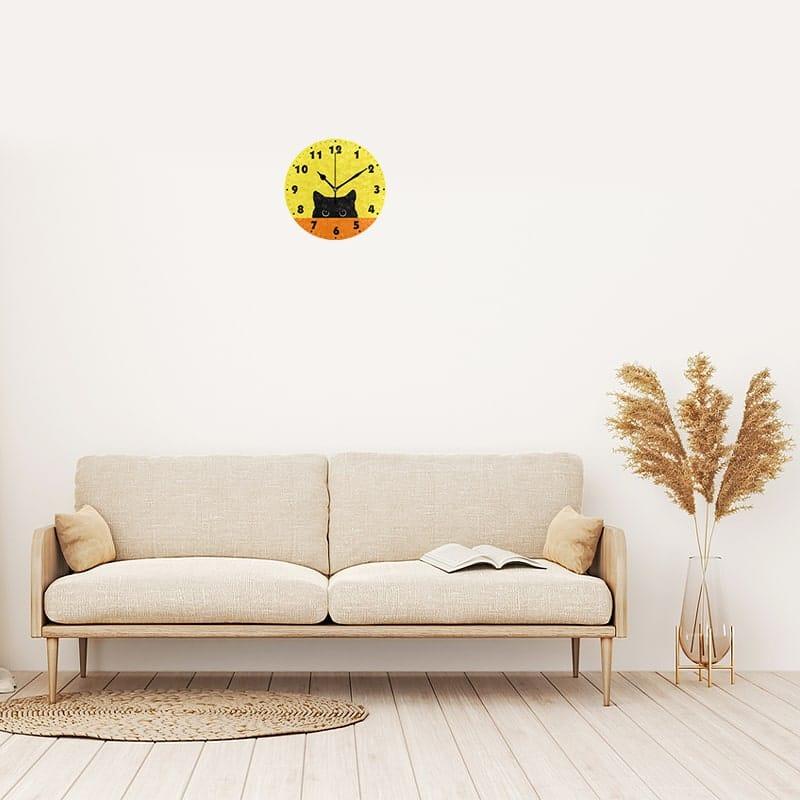 Horloge murale design chat dans le séjour